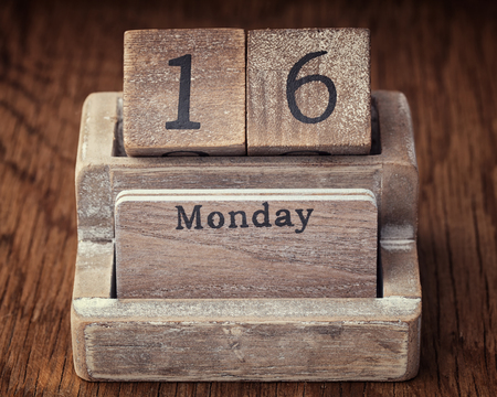 sixteen year old: Grunge calendar showing Monday the  sixteenth on wood background
