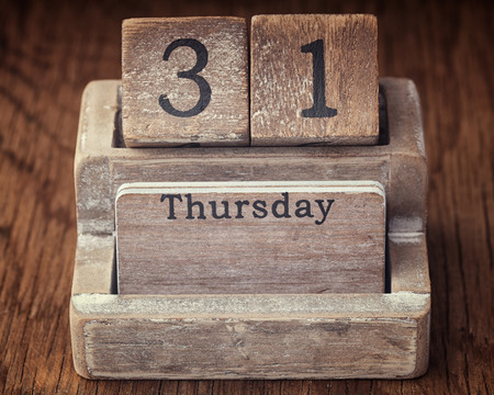 the thursday: Grunge calendar showing Thursday the thirty first on wood background