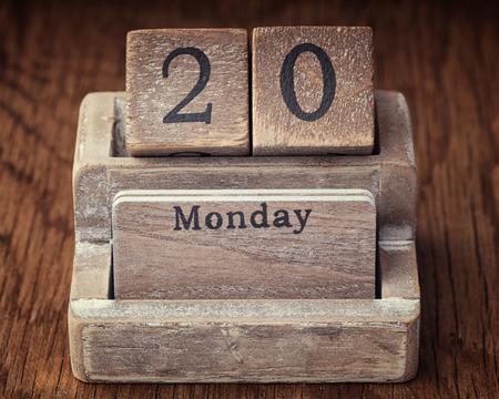 twentieth: Grunge calendar showing Monday the  twentieth on wood background