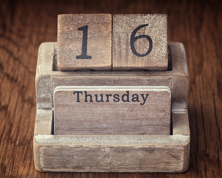 sixteen year old: Grunge calendar showing Thursday the sixteenth on wood background