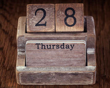 the thursday: Grunge calendar showing Thursday the twenty eighth on wood background Stock Photo