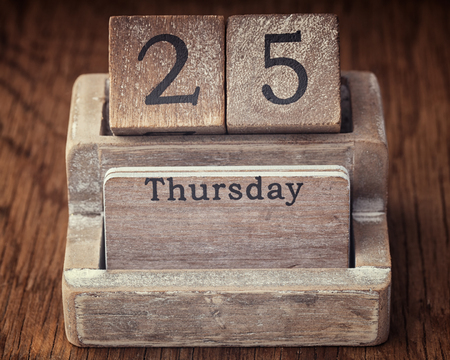 the thursday: Grunge calendar showing Thursday the twenty fifth on wood background