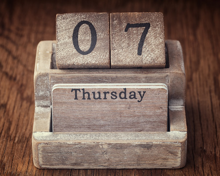 thursday: Grunge calendar showing Thursday the seventh on wood background