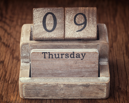 ninth: Grunge calendar showing Thursday the ninth on wood background