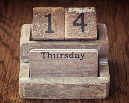 fourteenth: Grunge calendar showing Thursday the fourteenth on wood background