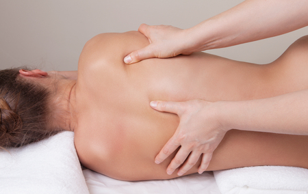 therapeutic massage: Deep tissue massage on the womans back