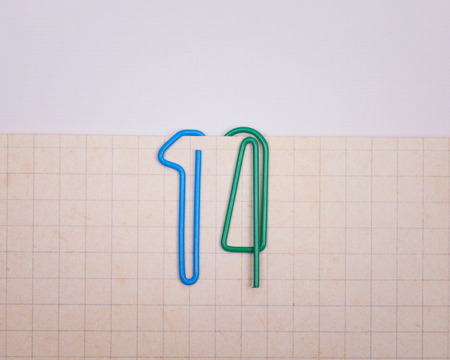 fourteen: Concept of number fourteen  made from colorful paper clips attached to vintage paper