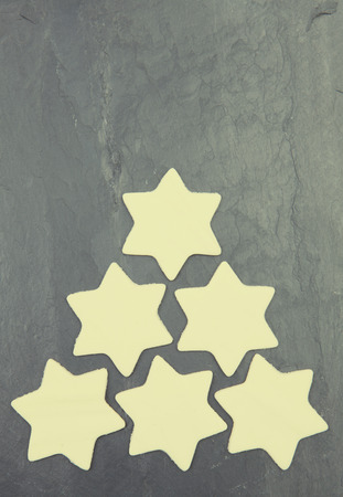 star shaped: Star shaped cookies on a black tile vintage surface Stock Photo