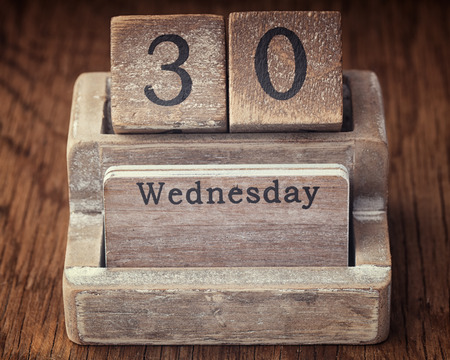 30 year old: Grunge calendar showing Wednesday the thirtieth on wood background