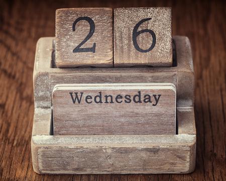 wednesday: Grunge calendar showing Wednesday the twenty sixth  on wood background