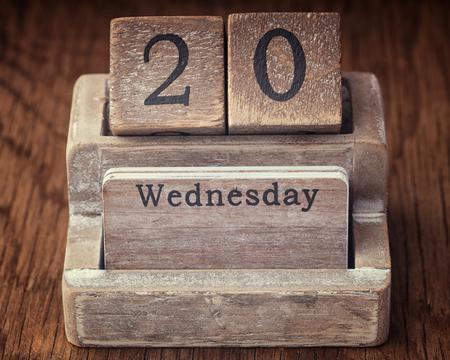 twentieth: Grunge calendar showing Wednesday the  twentieth on wood background Stock Photo