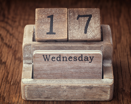wednesday: Grunge calendar showing Wednesday the seventieth  on wood background