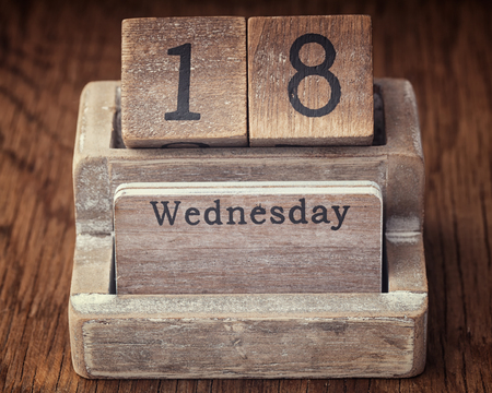 eighteenth: Grunge calendar showing Wednesday the eighteenth on wood background Stock Photo