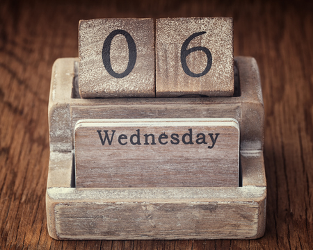 the sixth: Grunge calendar showing Wednesday the sixth on wood background