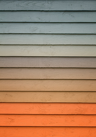 balance rainbow colors: A wooden wall with a various amount of colors painted on it