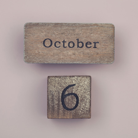 six month old: Wooden vintage calendar showing the date 6th of October Stock Photo