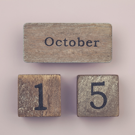 15 months old: Wooden vintage calendar showing the date 15th of October Stock Photo