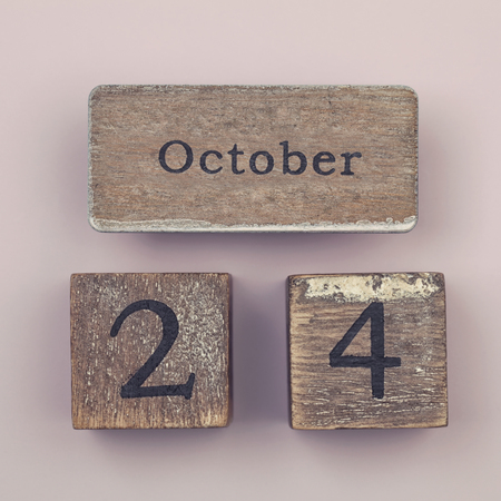 twenty four month old: Wooden vintage calendar showing the date 24th of October