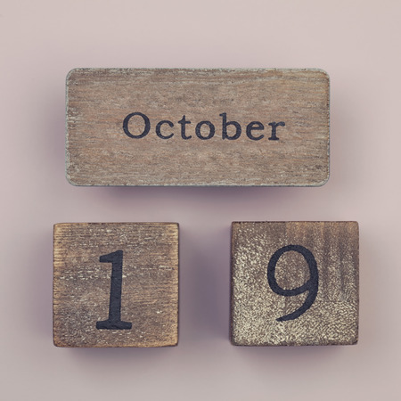 19 year old: Wooden vintage calendar showing the date 19th of October