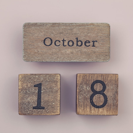 18 month old: Wooden vintage calendar showing the date 18th of October Stock Photo