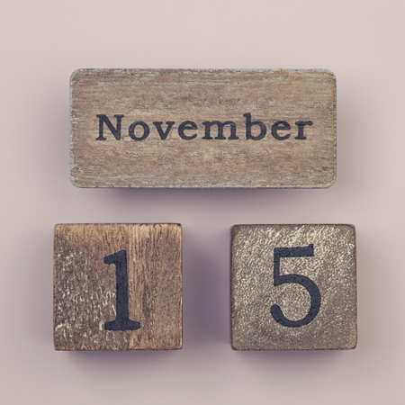 fifteen year old: Wooden vintage calendar showing the date 15th of November