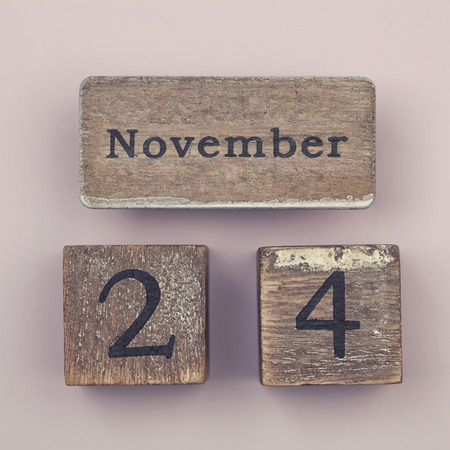 twenty four month old: Wooden vintage calendar showing the date 24th of November