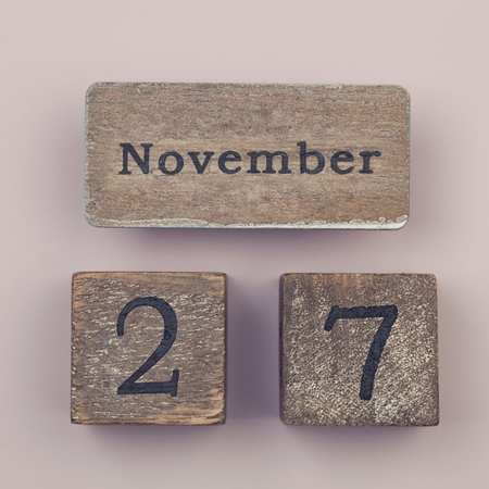 27 years old: Wooden vintage calendar showing the date 27th of November Stock Photo