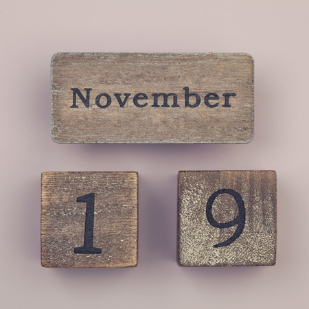 19 year old: Wooden vintage calendar showing the date 19th of November