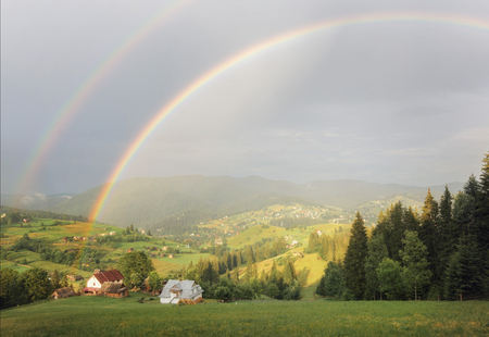 Rainbow over the mountains Stock Photo