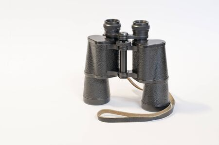 Black binoculars on a white background. 写真素材