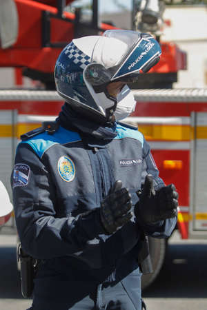 A Coruna-Spain.Portrait of A Coruña local police wearing a motorcycle helmet and mask due to the crisis of the covid-coronavirus pandemic-19 on March 26, 2020 Editorial
