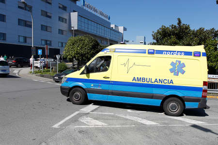 A Coruña-Spain.Spain ambulance car, 061 or 112 emergency medical service in mission . Coronavirus worldwide outbreak crisis. Spread of the COVID-19 virus on March 26,2020