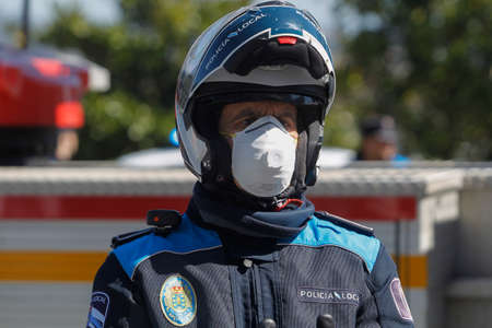 A Coruna-Spain.Portrait of A Coru? ? a local police wearing a motorcycle helmet and mask due to the crisis of the covid-coronavirus pandemic-19 on March 26, 2020 Editorial
