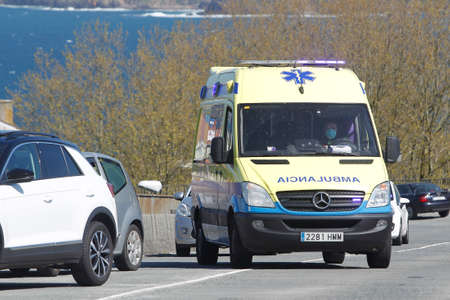 A Coru? ? a-Spain.Spain ambulance car, 061 or 112 emergency medical service in mission. Coronavirus worldwide outbreak crisis. Spread of the COVID-19 virus on March 26,2020