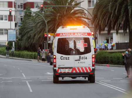 Spain ambulance car, emergency medical service in mission . Coronavirus worldwide outbreak crisis. Spread of the COVID-19 virus