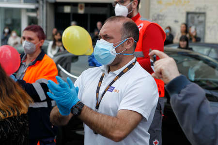 Coruña-Spain.Healthcare workers wearing facemasks facing coronavirus crisis applaud on May 10,2020 Editorial