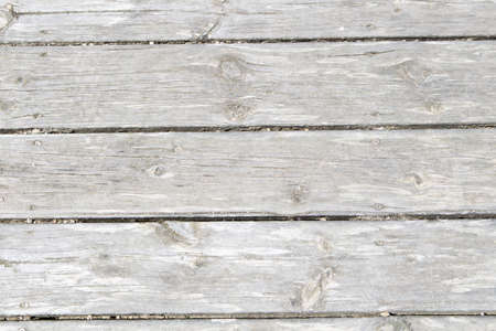 close-up of gray wooden slats on walkway