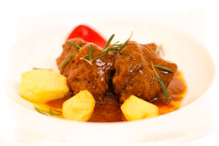 Roasted meat with potatoes and red pepper with sauce