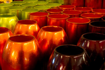 lot of green, orange and brown vases