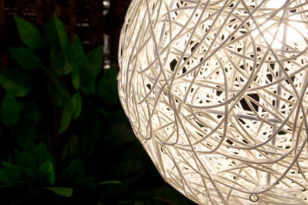 modern lamp on green leaves background Foto de archivo