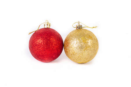 textured red and gold christmas balls on white background