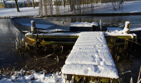 Boat on the water at winter photo