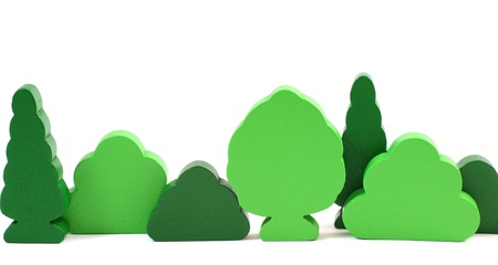 Wooden toy trees isolated on white background