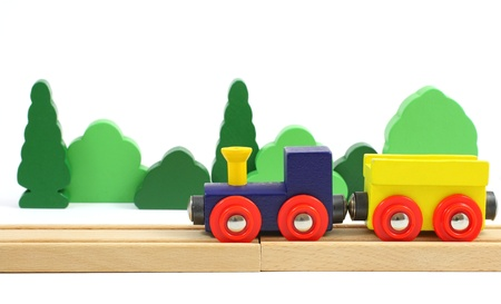 Wooden train on the railroad and trees   isolated over white Stock Photo