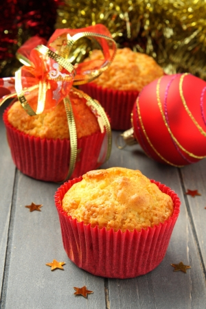 Muffins in red cups with christmas decoration photo