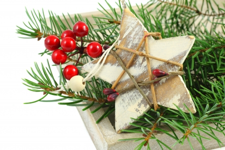 Christmas composition with branch of Christmas tree and decorations isolated over white Stock Photo