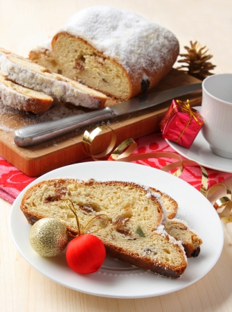 Sliced stollen with christmas decoration, a traditional German fruit cake Stock Photo - 17006237