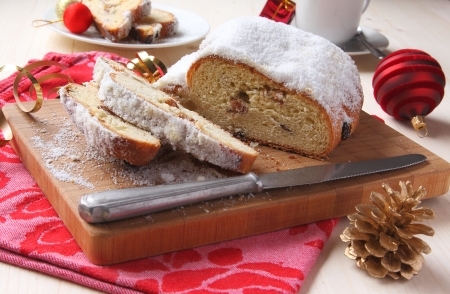 Sliced stollen with christmas decoration, a traditional German fruit cake Stock Photo - 17006391