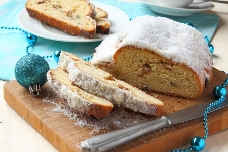 Sliced stollen with christmas decoration, a traditional German fruit cake Stock Photo - 17007246