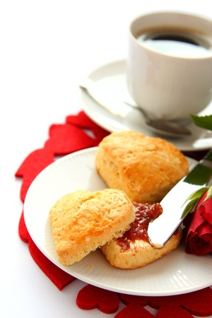 Heart shaped scones with strawberry jam and a cup of tea Stock Photo - 17307613